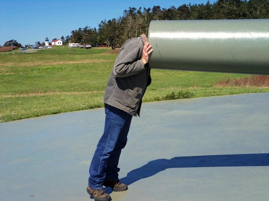 Fort Casey State Park: My friend checking out the inside of the cannon -  3-31-2013
