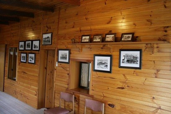 A Settlers Cottage: Rose Cottage Famliy room contains a collection of historical photos