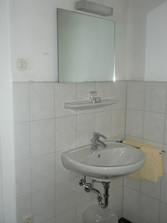 Hotel Pension Theresia: close up of sink in room