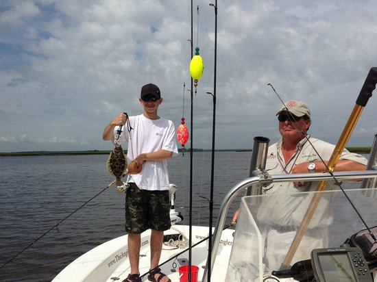 Angler's Mark Fishing Charter : Capt. Piper and our son Seth with an (undersized) flounder.