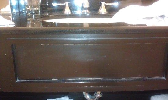 The Saratoga Hilton: Finish peeling off the furniture in the tiny bathroom