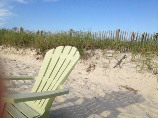 Inn On The Beach : Adirondack chairs just off the deck