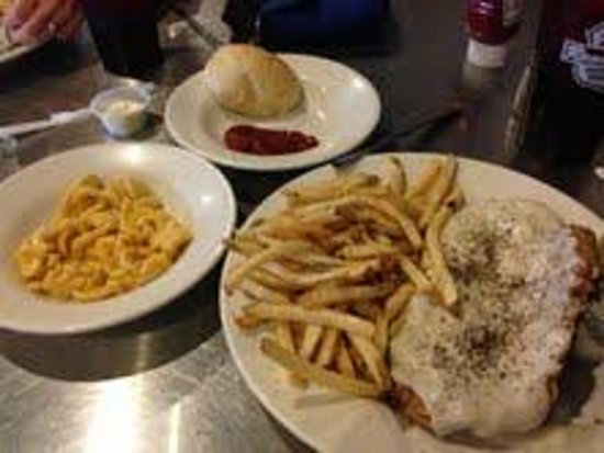 287 Roadhouse Restaurant & Sportsbar: Chicken fried steak with fries, mac and cheese and rolls.