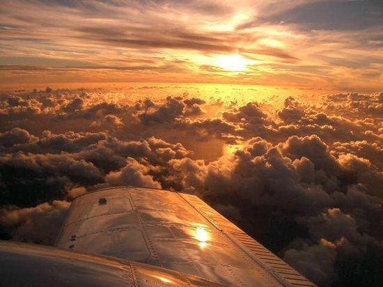 Paia, HI: Sunset Flight Over the Islands
