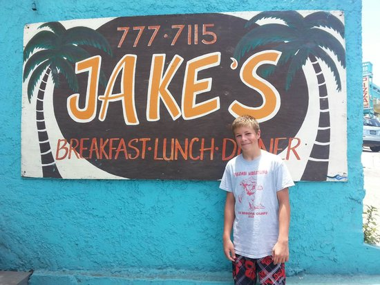"Jake's : My son, Jake in front of the sign with ""his"" name on it."