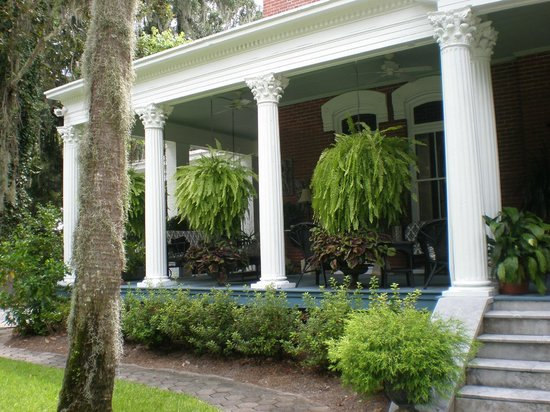 Brunswick Manor: Front Porch With Hanging Ferns Everywhere