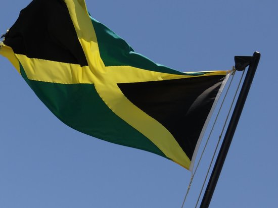Mystic Dining Restaurant and Bar : Jamaican Flag atop the restaurant!