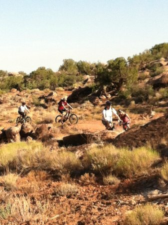 Solfun Mountain Biking : Group of four riding with guide Phil