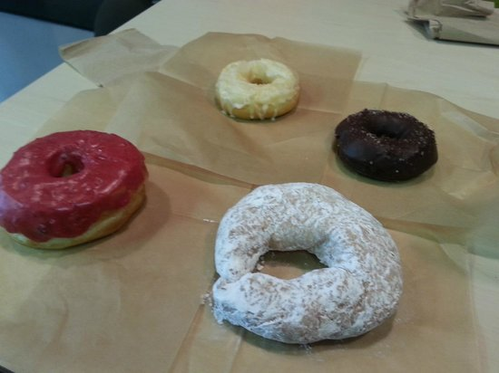 Glazed Gourmet Doughnuts: Raspberry, lemon, mocha and the delicious black and white!