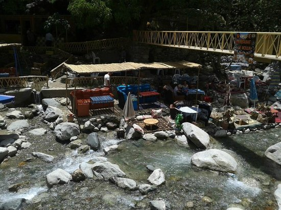 Caminhos de Marrocos - Day Tours: Sofas and tables alongside the river at Ourika