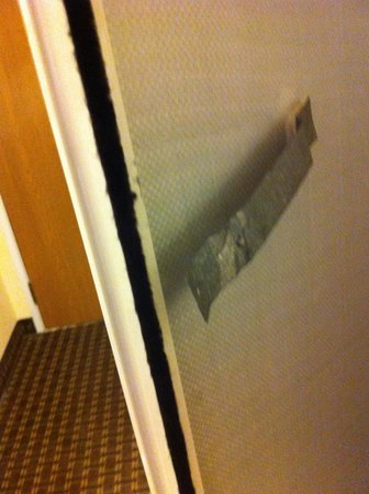 Holiday Inn Express Hotel & Suites Port Aransas / Beach Area: closet door taped up