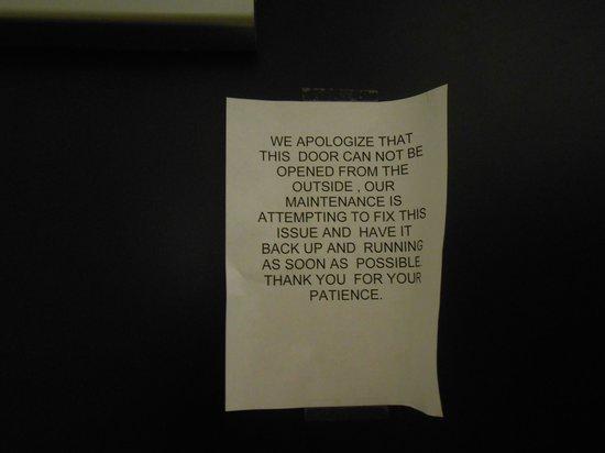 Red Lion Inn and Suites Eugene: Tattered sign on exit door - inside