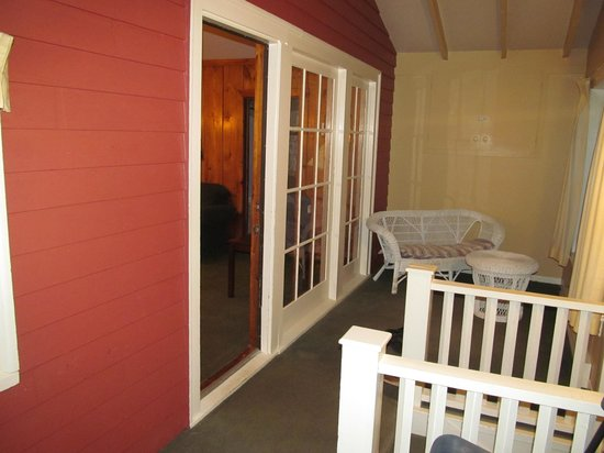 Inverary Resort: Lovely front porch in need of new furniture and windows that open.