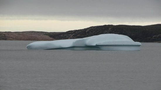 Battle Harbour Heritage Properties: iceberg offshore