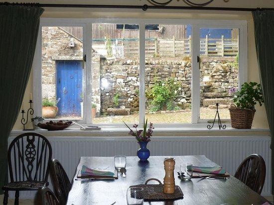 Nethergill Farm: Dinner table overlooking farm courtyard