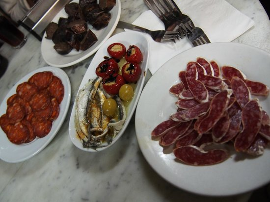 Barcelona Food Tour: A selection of chorizos and white anchovies in vinaigrette.