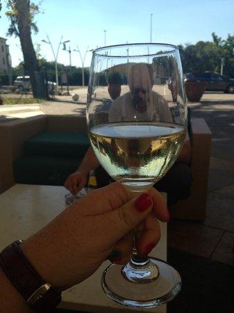 CDH Hotel Villa Ducale: glass of prosecco outside the hotel