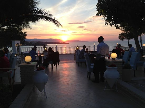 Amazing sun set view picture of balcony blue and sea for Restaurants with balcony