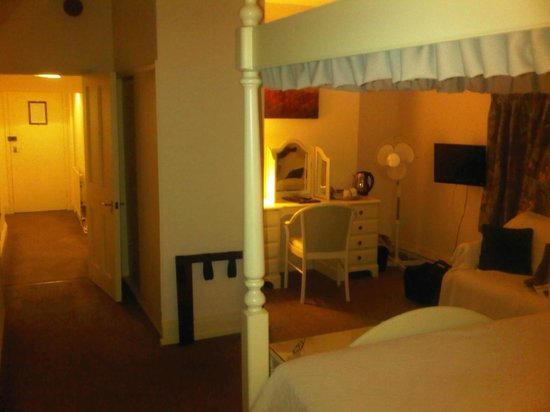 The Lion Hotel: bedroom - view from bed, door in distance at end of corridor