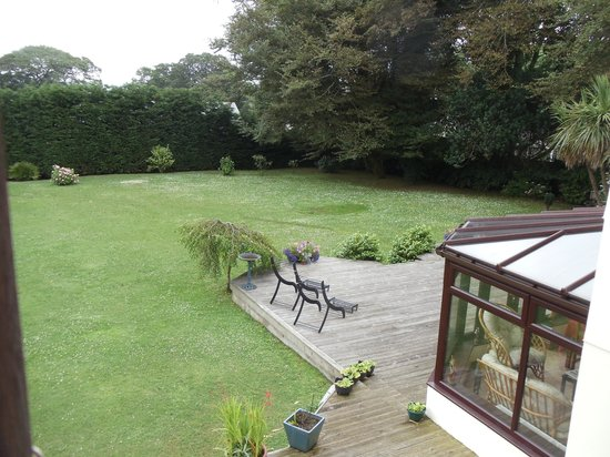 The Cedars B&B: View of rear garden from Room 5 showing corner of conservatory