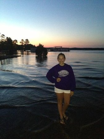Mountain Harbor Resort: Our daughter enjoying a gorgeous Lake Ouachita sunset at Mountain Harbor Marina.