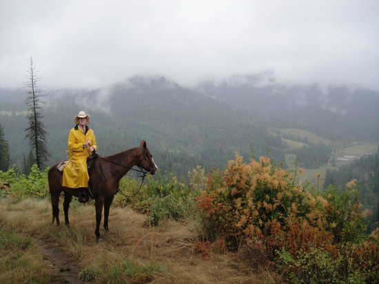 Red Horse Mountain Ranch: riding rain or shine. the ranch below.