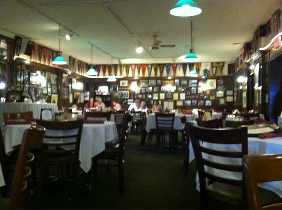 The Savoy Restaurant: Walls are festooned with pennants from colleges everywhere