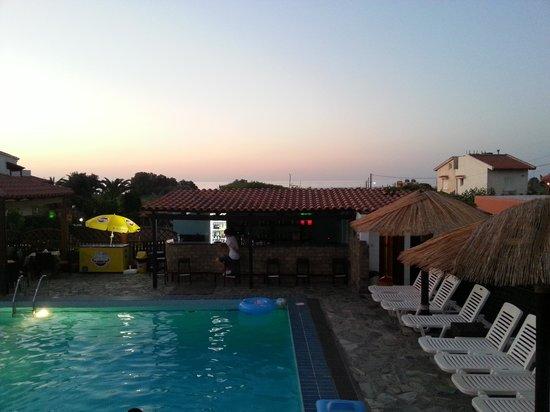Ledra Maleme: View of pool bar & sea out of room window.