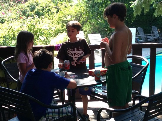 Mountain Home Ranch: Card games on Grandpa's deck with pool in background