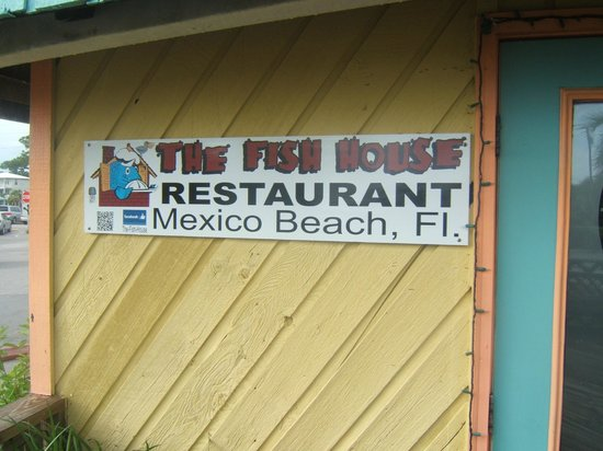 Fish House Restaurant Sign At Entrance