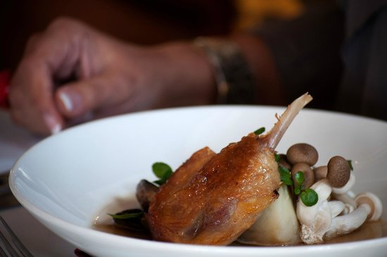 Zest Restaurant: Confit duck with smoked potato, duck consommé & wild mushroom.