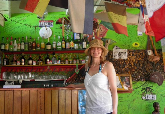 Robert Righteous & De Youths Seafood Restaurant & Bar: In front the bar where many happy memories are borne as cares fall away in the warm Caribbean ni