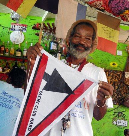Robert Righteous & De Youths Seafood Restaurant & Bar: Robert holds yacht club pennant.