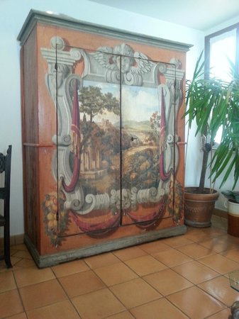 Hotel Columbia: The beautiful painted wardrobe in the lounge area