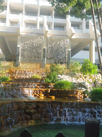 SENTIDO Zeynep Golf & Spa: Waterfall at the front of the resort hotel