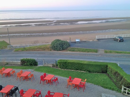 Hôtel du Casino : View of dining downstairs and Omaha Beach from room.