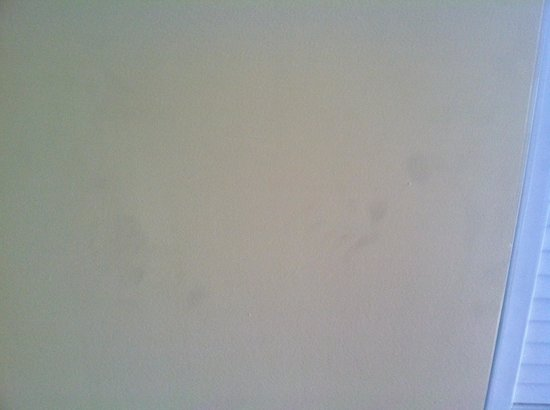 Camelot By The Sea, Oceana Resorts: Black hand prints on living room walls