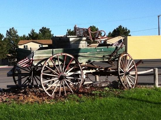 Prospector Hotel and Gambling Hall: Old time transportation lawn ornament.