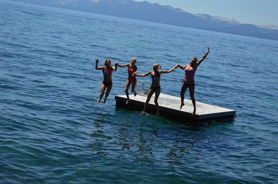 Brockway Springs Resort: Girls having fun jumping off floating dock!