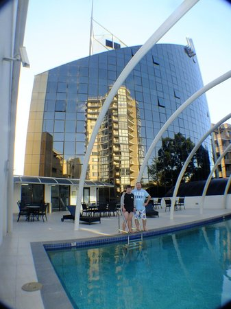 Novotel Sydney Parramatta: Heated outdoor pool, hotel in background