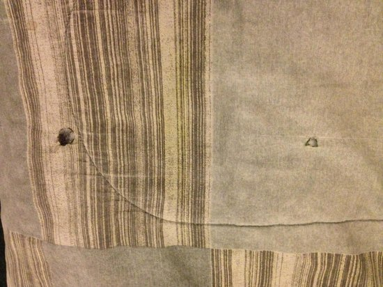 St. Vincent's Guest House : Cigarette burns on comforter
