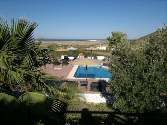 Hotel Sindhura: From just outside our terrace, looking down onto the pool and out towards the sea