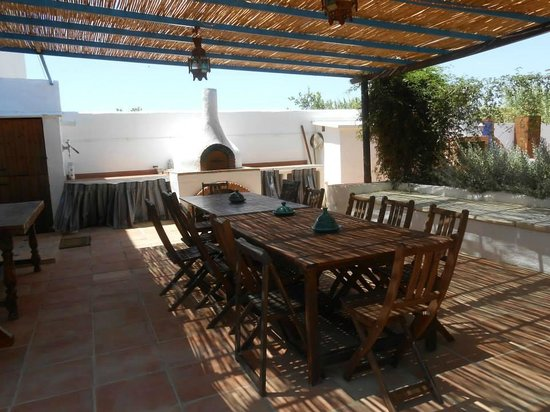 Finca Al Limón: Pizza oven and one of the dining areas