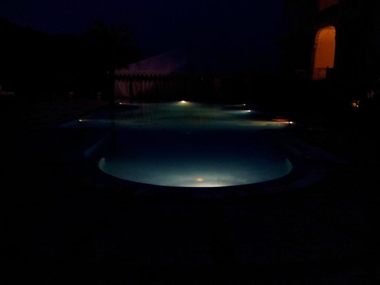 Rajasthali Resort and Spa : Pool by night