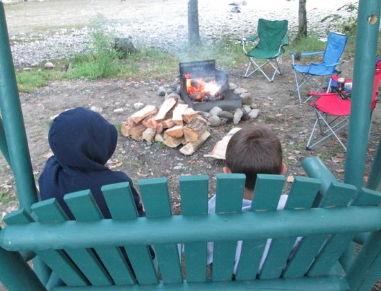 Herkimer KOA Campground: Swing w/cooking grate/fire pit and West Canada Creek