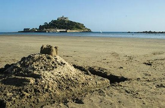 Sandcastle and a real castle - St Michael's Mount, Marazion in Cornwall