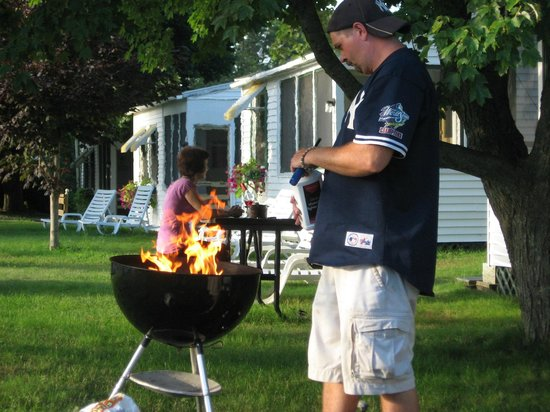 The Beaches Motel & Cottages: My husband cooking out,Grills and lighter fluid,Charcole provided