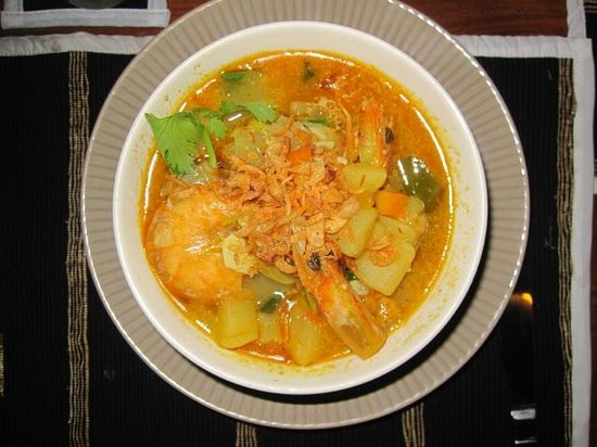 "Man Dollow Cafe : Delicious seafood-curry, served with rice. If you are brave, order it ""balinese"" style = spicy.."