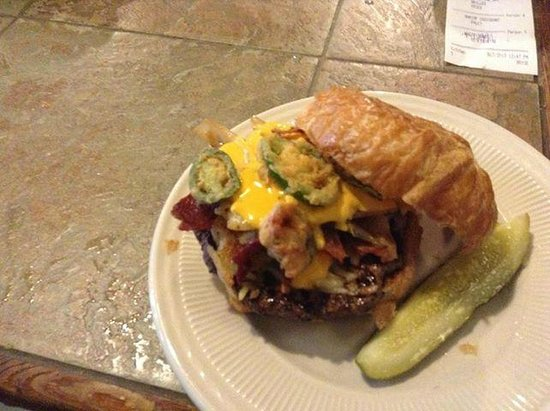 Sandcastle Cafe & Grill: How 'bout a burger on a croissant, topped with bacon, hash browns, cheese sauce, grilled onions