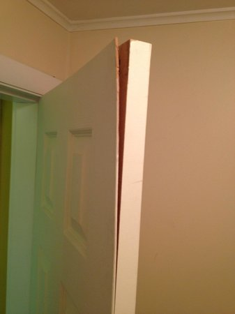 The Stowe Inn: bathroom door splitting apart (can't close the door because it is so warped)